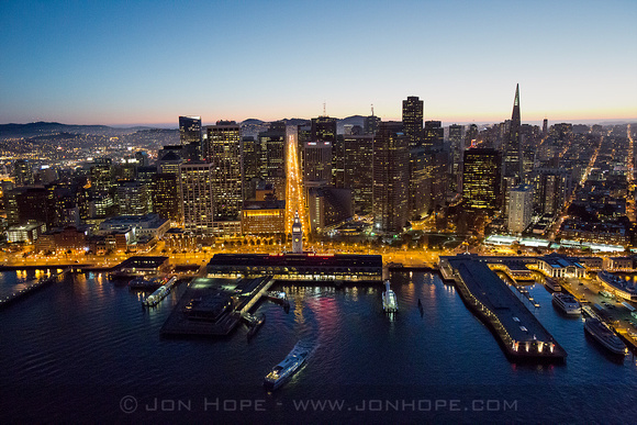 Aerial view of the Ferry Building at dusk shot from a helicopter