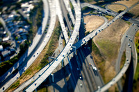Using a tilt shift lens makes this aerial shot of a freeway junction look like a model