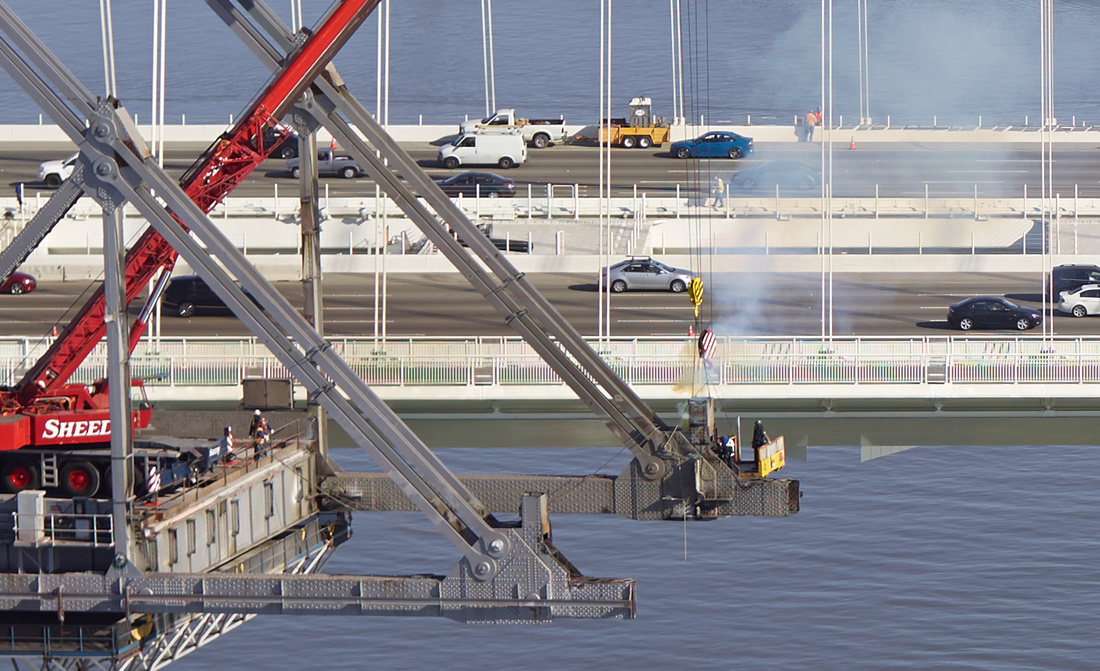 Aerial detail of workers dismantling the old span of the Bay Bridge